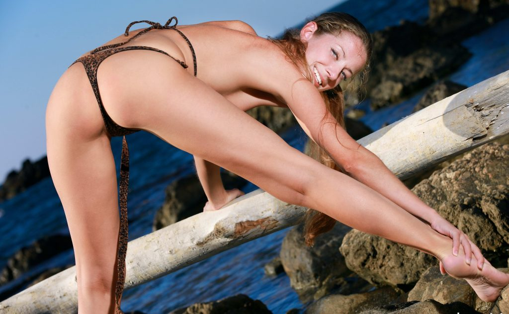 A Teen Stretching Her Leg And Ass